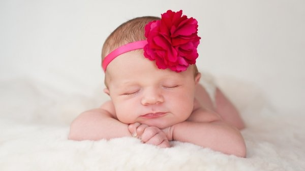 depositphotos_35975415-stock-photo-newborn-baby-girl-with-hot-Cropped.jpg