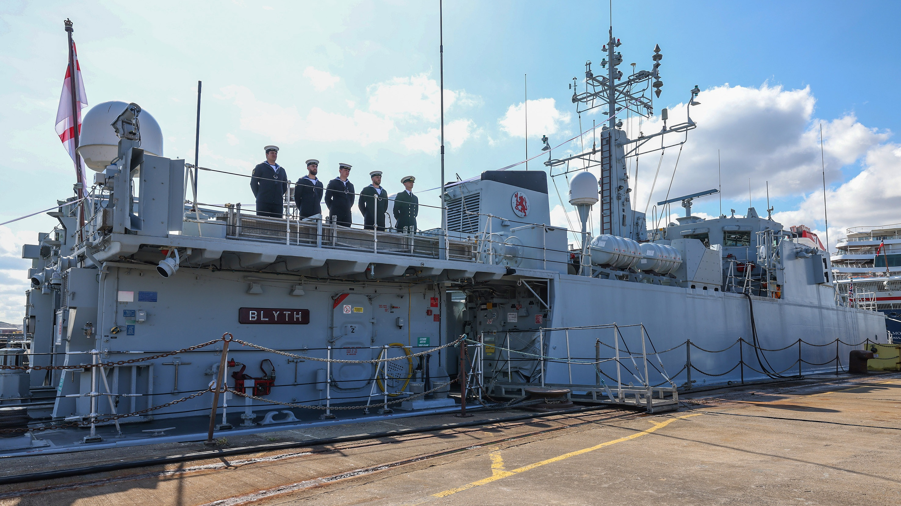 Five-sailors-stand-on-Blyths-upper-deck-for-the-ceremony-Cropped.jpg